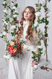 Gorgeous bride with flowers Stock Photo