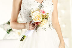 Gorgeous bride hands in a white room, posing Royalty Free Stock Photos