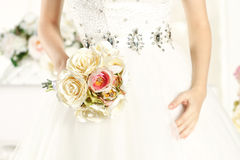Gorgeous bride hands in a white room, posing Royalty Free Stock Photo