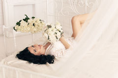 Gorgeous bride preparing to her wedding at the morning Stock Photography