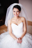 Gorgeous bride smiles. Beautiful Smiling Brunette Bride at home Stock Photo