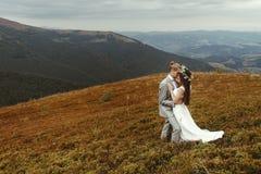 Gorgeous bride and stylish groom hugging,  boho wedding couple, Royalty Free Stock Images