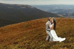 Gorgeous bride and stylish groom hugging,  boho wedding couple, Stock Photos