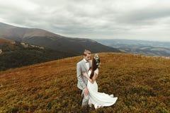 Gorgeous bride and stylish groom hugging,  boho wedding couple, Royalty Free Stock Image