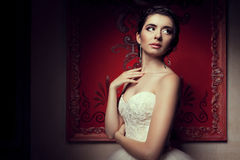 Gorgeous bride in wedding dress in vintage interior Stock Image
