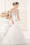 Gorgeous bride with white dress with flowers bouquet Royalty Free Stock Photos