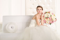 Gorgeous bride with white dress with flowers bouquet Stock Images