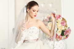 Gorgeous bride in a white room, posing Royalty Free Stock Images