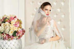 Gorgeous bride in a white room, posing Royalty Free Stock Photography