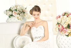 Gorgeous bride in a white room, posing Stock Photos