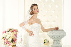 Gorgeous bride in a white room, posing Royalty Free Stock Image