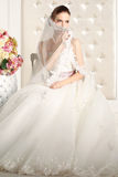 Gorgeous bride in a white room, posing Stock Photo
