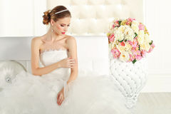 Gorgeous bride in a white room, posing Royalty Free Stock Photos