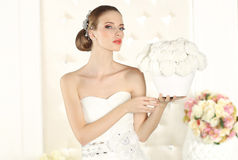 Gorgeous bride in a white room, posing Stock Image