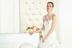 Gorgeous bride in a white room, posing Stock Photography