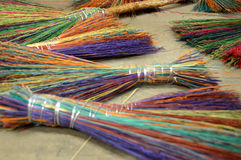 Gorgeous brooms of rainbow colors Stock Photos