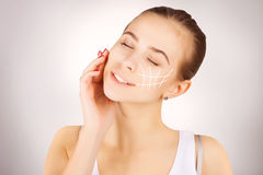 Gorgeous brown eyed blond model  with skin surgery mark on grey Stock Images