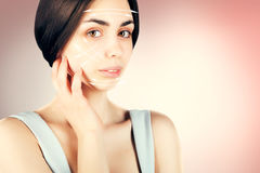 Gorgeous brown eyed dark haired model portrait with skin surgery mark Stock Photos