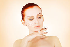 Gorgeous brown eyed red haired model portrait with skin surgery Royalty Free Stock Photography