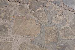 Gorgeous Brown Stone Wall Of Mikonos. royalty free stock photography