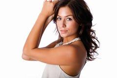 Gorgeous brunette. Model poses wearing halter top set against white backdrop Stock Photography