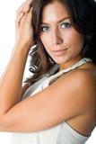 Gorgeous brunette. Model poses wearing halter top set against white backdrop Stock Photos