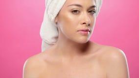 Gorgeous brunette in bathrobe stock footage