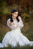 Gorgeous brunette beauty in a old-fashioned dress Stock Image