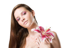 Gorgeous brunette beauty shot with flower. Royalty Free Stock Images