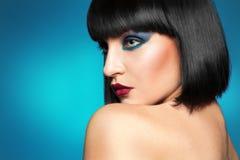 Gorgeous brunette on blue background Stock Photos