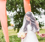Gorgeous  Brunette bride with bouquet outdoor, posing Stock Images