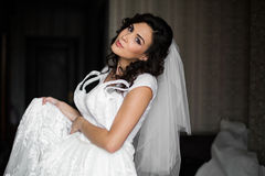 Gorgeous brunette bride posing with luxury white wedding dress Royalty Free Stock Images