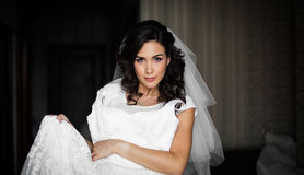 Gorgeous brunette bride posing with luxury white wedding dress a Royalty Free Stock Image