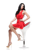 Gorgeous brunette on chair Royalty Free Stock Photos