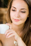 Gorgeous brunette in the coffee shop. Stock Photography
