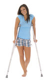 Gorgeous brunette on crutches Stock Photos