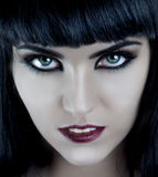 Gorgeous brunette with dark makeup and white skin. Gorgeous brunette with dark makeup, white skin, blue eyes Royalty Free Stock Image