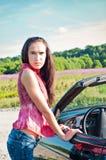 Gorgeous brunette female standing near car Stock Image