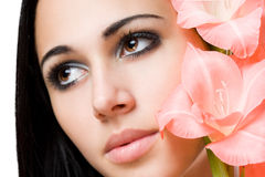 Gorgeous brunette with flower. Royalty Free Stock Photo