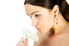 Gorgeous brunette with flower. Isolate on white Stock Photography