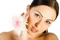 Gorgeous brunette with flower. Isolate on white Royalty Free Stock Photo