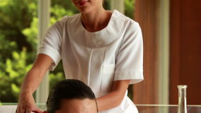 Gorgeous brunette getting a massage stock footage