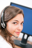 Gorgeous brunette with headset. Stock Photography