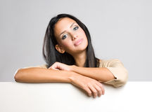Gorgeous brunette holding empty banner. Royalty Free Stock Photos
