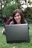 Gorgeous Brunette Lady and Laptop Computer Stock Image