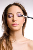 Gorgeous brunette with makeup tools, brushes. Stock Photos