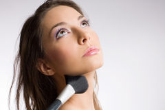 Gorgeous brunette with makeup tools, brushes. Stock Photography