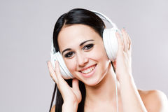 Gorgeous brunette music lover. Royalty Free Stock Image