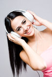 Gorgeous brunette music lover. Stock Photos