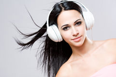 Gorgeous brunette music lover. Stock Images